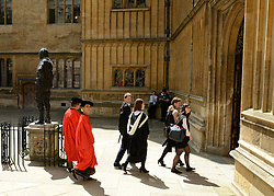 © Licensed to London News Pictures. 20/06/2012. Oxford, UK Aung San Suu Kyi (looking at the camera scarlet robe) arrives at Oxford University today 20 June 2012 ahead of receiving an Honary Degree at the Encaenia Ceremony.  The Burmese democracy leader is to receive an honorary doctorate in civil law at annual ceremony honouring the brightest and best. Other honorees include: former MI5 Director General Baroness Manningham-Buller; author David John Moore Cornwell (aka John le Carre); Harvard University president Professor Drew Gilpin Faust; and Sony chief executive Sir Howard Stringer. Photo credit : Stephen Simpson/LNP