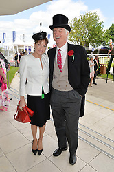 EMILY OPPENHEIMER and her brother in law STEPHEN LUSSIER at the Investec Derby 2015 at Epsom Racecourse, Epsom, Surrey on 6th June 2015.