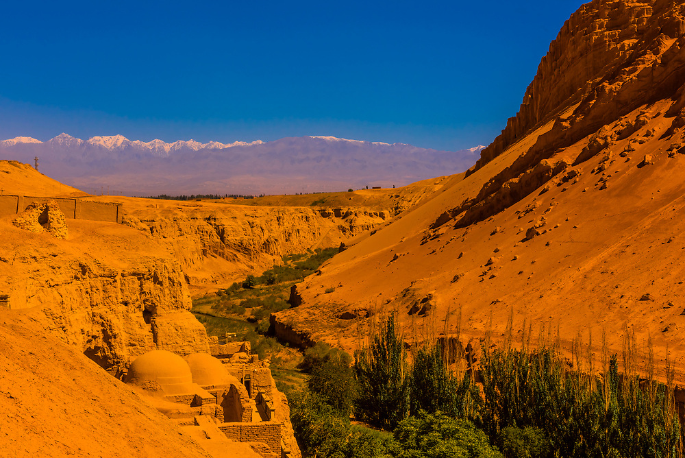 Views of The Flaming Mountains, red sandstone hills in Tian Shan Mountain range,  from the Bezeklik Thousand Buddha Caves, Xinjiang, China. They lie near the northern rim of the Taklamakan Desert and east of the city of Turpan.