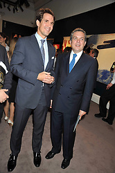 Left to right,CROWN PRINCE PAVLOS OF GREECE and CHRISTOS ZAMPOUNIS at a party to celebrate the publication of Elena Makri Liberis's book 'Every Month, Same day' held at Sotheby's, 34-35 New Bond Street, London on 5th May 2009.