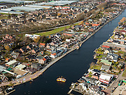 Nederland, Zuid-Holland, Gemeente Kaag en Braassem, 20-02-2012; pontje tussen Roelofsarendsveen en Oude Wetering (re) over het gelijknamige water.A ferry on the watercourse Oude Wetering. .luchtfoto (toeslag), aerial photo (additional fee required);.copyright foto/photo Siebe Swart.