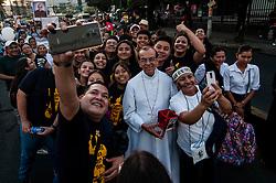 Cardinal Mons. GREGORIO ROSA CHAVEZ greets Catholics.
