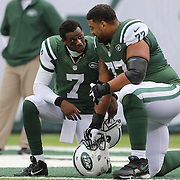 Geno Smith, (left), New York Jets, talking with team mate Austin Howard before the New York Jets Vs Miami Dolphins  NFL American Football game at MetLife Stadium, East Rutherford, NJ, USA. 1st December 2013. Photo Tim Clayton