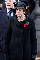 © Licensed to London News Pictures. 12/11/2017. London, UK. British Prime Minister THERESA MAY attends a Day Ceremony at the Cenotaph war memorial in London, United Kingdom, on November 13, 2016 . Thousands of people honour the war dead by gathering at the iconic memorial to lay wreaths and observe two minutes silence. Photo credit: Ray Tang/LNP