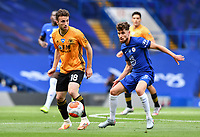 Football - 2019 / 2020 Premier League - Chelsea vs. Wolverhampton Wanderers<br /> <br /> Wolverhampton Wanderers' Diogo Jota holds off the challenge from Chelsea's Jorginho, at Stamford Bridge.<br /> <br /> COLORSPORT/ASHLEY WESTERN