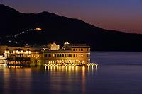 UDAIPUR, INDIA - CIRCA NOVEMBER 2016:  Lake Palace Hotel formerly known as Jag Niwas at night in Lake Pichola in Udaipur