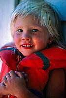 Norwegian girl wearing lifejacket, Kragero (on the Oslo fjord), Norway