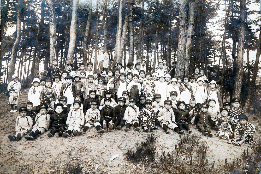 large group portrait of young childeren outdoors Japan ca 1940s