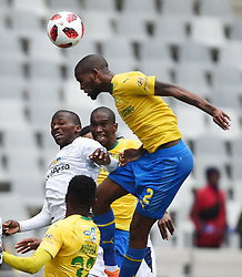 Cape Town-180825- Cape Town City player Thami Mkhize challenges Mamelodi Sundowns defender Mosa Lebosa  for ana aerial ball in the MTN 8 semi-final at Cape Town Stadum.Photographer :Phando Jikelo/African News Agency/ANA