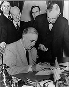 Franklin Delano Roosevelt (1882-1945) 32nd President of the United States of America 1933-1945, signing the declaration of war against Germany, 11 December 1941.