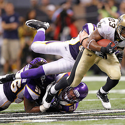 September 9, 2010; New Orleans, LA, USA;  New Orleans Saints running back Pierre Thomas (23) breaks a tackle to get a first down during the fourth quarter securing a 14-9 win over the Minnesota Vikings in the NFL Kickoff season opener at the Louisiana Superdome.  Mandatory Credit: Derick E. Hingle