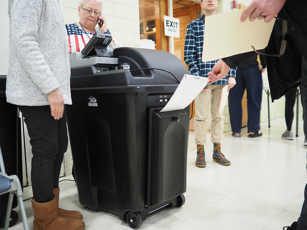 When the optical scanner does not work, voters put their ballots into a secure locked slot in the back of the optical scanner.