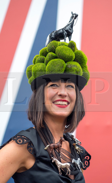 © Licensed to London News Pictures. 19/06/2014. Ascot, UK. Tiffany Rowe wears a hat featuring a horse.  Day three, Ladies Day, at Royal Ascot 19th June 2014. Royal Ascot has established itself as a national institution and the centrepiece of the British social calendar as well as being a stage for the best racehorses in the world. Photo credit : Stephen Simpson/LNP
