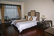 Vietnam, Hue, Interior of the Imperial Hotel Bedroom