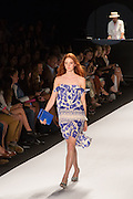 A muted wedgewood blue and white print dress with spaghetti straps.