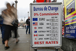 © Licensed to London News Pictures. 03/02/2020. LONDON, UK.  People pass by signs outside a foreign currency exchange near Trafalgar Square.  Boris Johnson, Prime Minister, has given a speech in Greenwich calling for a Canada-style free trade deal between the UK and European Union.  In the EU-Canada deal import tariffs on most goods have been eliminated between the two countries, but some customs and VAT checks still exist.  Currency markets have seen a fall in sterling in reaction to the speech. Photo credit: Stephen Chung/LNP