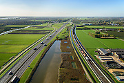 Nederland, Gelderland, Betuwe, 24-10-2013; Betuweroute, ter hoogte van Echteld. De goederenspoorlijn loopt parallel aan autosnelweg A15. De goederentrein is onderweg naar de haven van Rotterdam.<br /> Betuweroute, railway from Rotterdam to Germany, near Echteld. The freight railway runs parallel to highway A15. The freight is on its way to the port of Rotterdam.<br /> luchtfoto (toeslag op standaard tarieven);<br /> aerial photo (additional fee required);<br /> copyright foto/photo Siebe Swart.