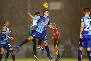Wycombe Wanderers midfielder Luke Bolton on loan from Manchester City (17) heads the ball during the EFL Sky Bet League 1 match between Wycombe Wanderers and Plymouth Argyle at Adams Park, High Wycombe, England on 26 January 2019.