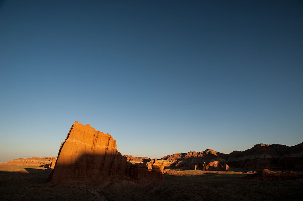 Temple of the Sun and Temple of the Moon glow in evening light, Cathedral Valley Loop, Capitol Reef National Park, Utah