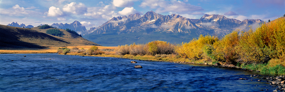 The Salmon River courses wide and azure before the rugged Sawtooth range in Sawtooth NRA, Idaho.
