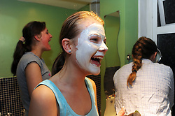 Teenage girls put on facemasks at a sleepover MODEL RELEASED