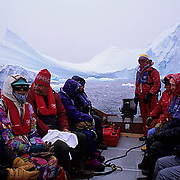 Antarctica, Tourists in Zodiak traveling along Antarctica Peninsula.