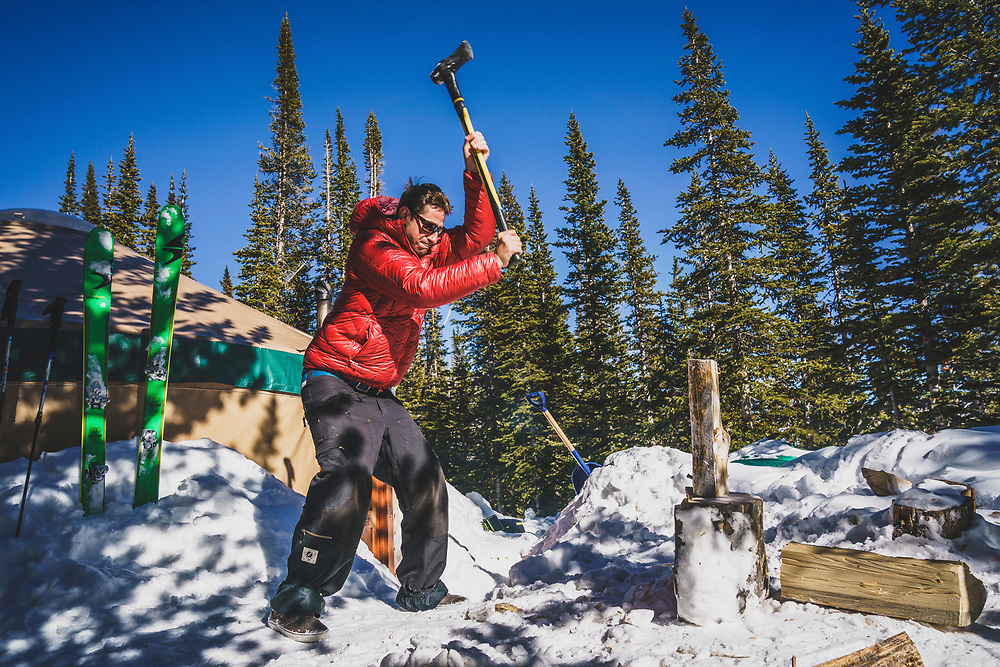 Josh Orwig splits wood at the Bell Lake Yurt, Tobacco Roots, Montana.