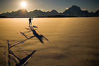 A young man skate skis on Jackson Lake in Grand Teton National Park, Jackson Hole, Wyoming.