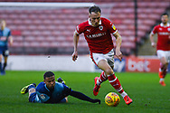 Cauley Woodrow of Barnsley (9) escapes Curtis Thompson of Wycombe Wanderers (18) during the EFL Sky Bet League 1 match between Barnsley and Wycombe Wanderers at Oakwell, Barnsley, England on 16 February 2019.