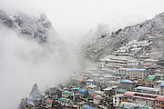 Snow and fog blankets the town of Namche Bazaar, the administrative center for the Khumbu (Mount Everest) region, Sagarmatha National Park, Himalaya Mountains, Nepal.