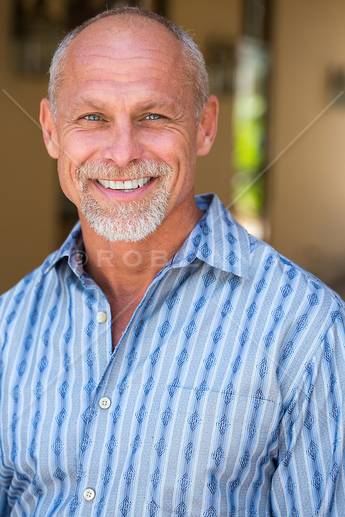 portrait of a handsome middle aged man smiling