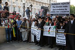 London, UK. 10th June, 2018. Imams and Orthodox Haredi Jews from Neturei Karta lead hundreds of people taking part in the pro-Palestinian Al Quds Day march through central London organised by the Islamic Human Rights Commission. An international event, it began in Iran in 1979. Quds is the Arabic name for Jerusalem.