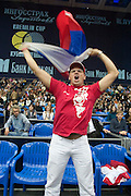 Moscow, Russia, 17/10/2004..The WTA Kremlin Cup tennis tournament. Russian fans cheer and wave national flags to encourage their players.
