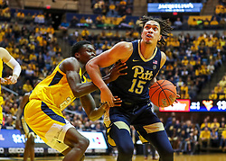 Dec 8, 2018; Morgantown, WV, USA; Pittsburgh Panthers forward Kene Chukwuka (15) makes a move in the lane during the first half against the West Virginia Mountaineers at WVU Coliseum. Mandatory Credit: Ben Queen-USA TODAY Sports