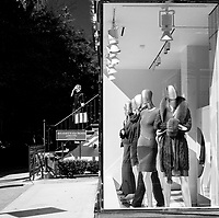 The Mannequins and young woman all seem to be waiting for something to happen on Madison Avenue, New York City.