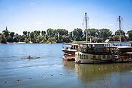 old ships on the banks of the river Rhine in the district Weiss, Cologne, Germany.<br /> <br /> alte Schiffe am Rheinufer im Stadtteil Weiss, Weisser Bogen, Koeln, Deutschland.