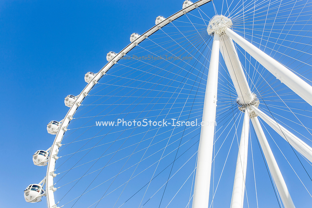 White Ferris Wheel with blue sky background