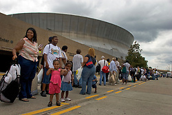 28th August, 2005. Hurricane Katrina, New Orleans, Louisiana. Thousands of people wait in line for a place of shelter in the Superdome the night before the storm hit.