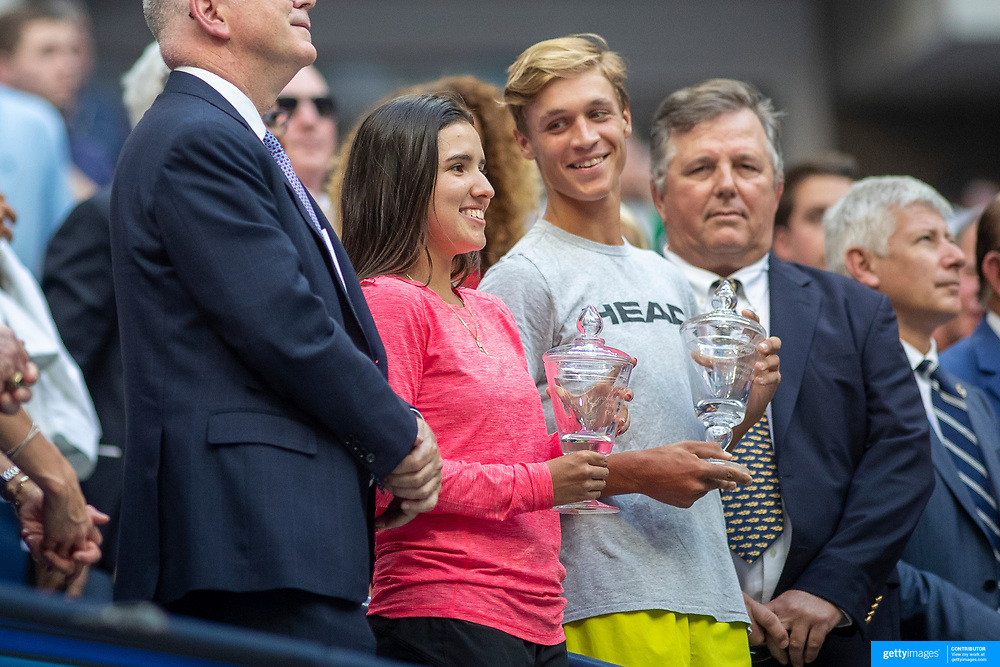 2019 US Open Tennis Tournament- Day Fourteen.  Maria Camila Osorio Serrano, the Junior Girls Singles Champion and Jonas Forejtek of the Czech Republic, the Junior Boys Singles Champion are presented to the Arthur Ashe Stadium audience during a change of ends during the Men's Singles Final on Arthur Ashe Stadium at the 2019 US Open Tennis Tournament at the USTA Billie Jean King National Tennis Center on September 8th, 2019 in Flushing, Queens, New York City.  (Photo by Tim Clayton/Corbis via Getty Images)