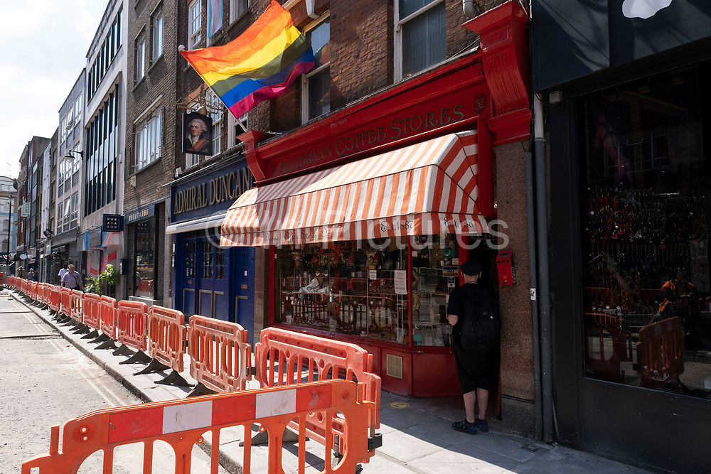 Rainbow flag outside the Admiral Duncan pub on Old Compton Street in Soho under coronavirus lockdown on 26th June 2020 in London, England, United Kingdom. As the July deadline approaces and government will relax its lockdown rules further, the West End remains quiet, while some non-essential shops are allowed to open with individual shops setting up social distancing systems.