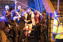 May 22, 2017 - Manchester, England, United Kingdom - Injured concert-goers are helped by police and emergency responders at the Manchester Arena after reports of an explosion. Manchester police reported 'a number of confirmed fatalities and others injured' as hundreds of fans fled the arena. (Credit Image: © Joel Goodman/London News Pictures via ZUMA Wire)