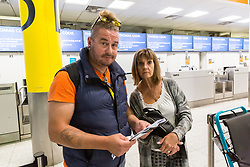 "Feeling ""abandoned"", Felixstow couple James, 45 and Kim, 60, Edgerton-Stanbridge, who were bound for a Red Sea holiday in Egypt, at the Thomas Cook Check-in after the travel company ceased trading after failing to come to a deal with its bankers and creditors, leaving tens of thousands of travellers unable to depart on their holidays from South Terminal at Gatwick Airport, and a massive repatriation exercise to return holidaymakers from destinations all over the world. London Gatwick Airport, September 23 2019."
