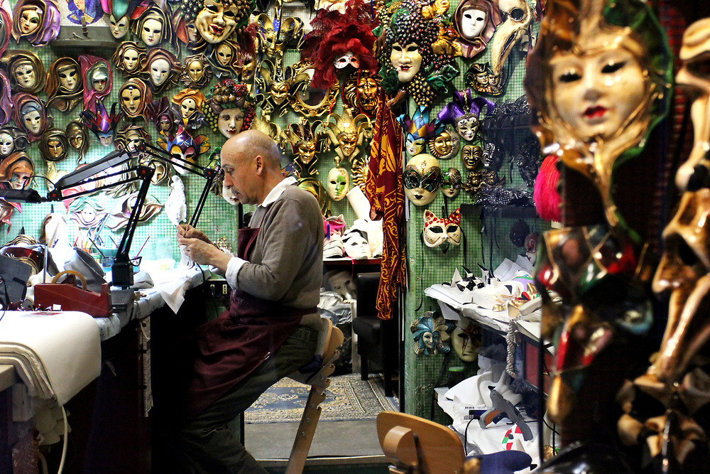 Artist working in mask shop, Venice, Italy, Europe.