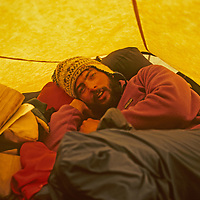 Ski mountaineer Allan Pietrasanta squeezes with two companions into a small two-person tent during a pioneering two-week ski expedition across India's Great Himalaya Range, from Ladakh to Kashmir.