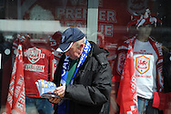 a Cardiff fan reads his match programme before the match. NPower championship, Cardiff city v Bolton Wanderers at the Cardiff city Stadium in Cardiff, South Wales on Saturday 27th April 2013. pic by Andrew Orchard,  Andrew Orchard sports photography,