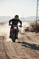 10x Honda motorcycle Ridden by Mark Samuels/Ian Young/Matt Eddy passes race mile 58 in 2012 San Felipe Baja 250, San Felipe, Baja California, Mexico.