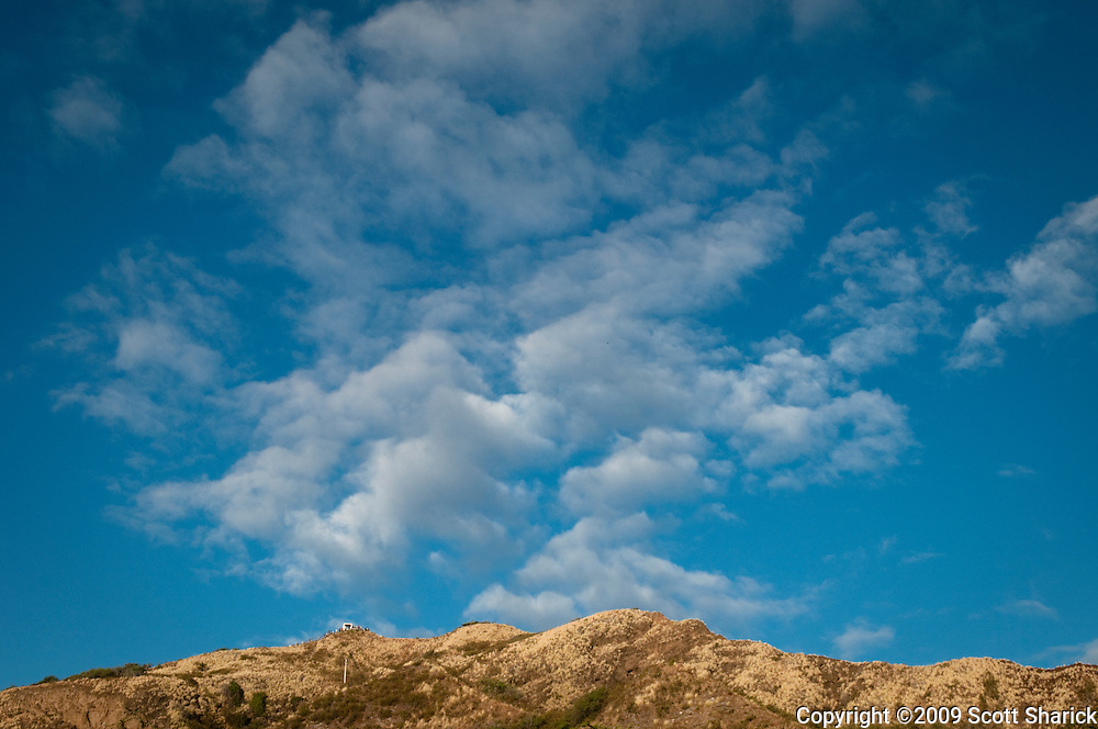 Clouds above the peak of Diamond Head Crater in Honolulu, Hawaii,