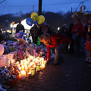Members of the public paying their respects at the shrine set up around the towns Christmas tree in Sandy Hook after the mass shootings at Sandy Hook Elementary School, Newtown, Connecticut, USA. 16th December 2012. Photo Tim Clayton