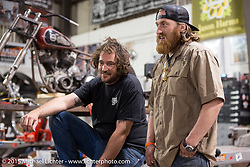 "Eric and Austin at Bill Dodge's ""Blings Cycles"" custom shop while friends meet up and work on their bikes after a long day at Daytona Beach Bike Week 2015. FL, USA. Monday March 9, 2015.  Photography ©2015 Michael Lichter."