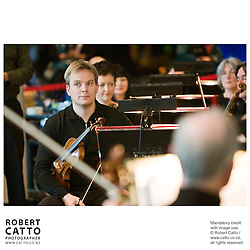 The New Zealand Symphony Orchestra (NZSO) perform a family concert in the Wellington Foyer of Te Papa Tongarewa, the national museum, with actors Gareth Williams, Miranda Harcourt, and Dame Kate Harcourt.